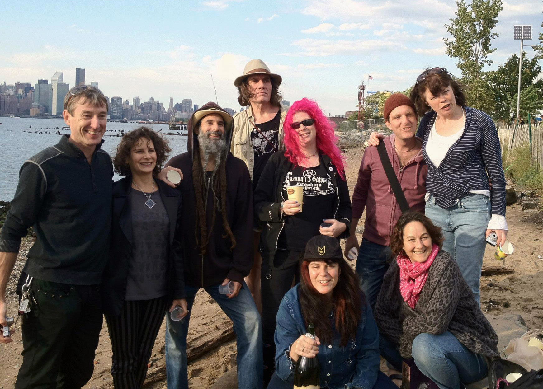 Gathering on the Williamsburg waterfront to release the ashes of a friend into the river.