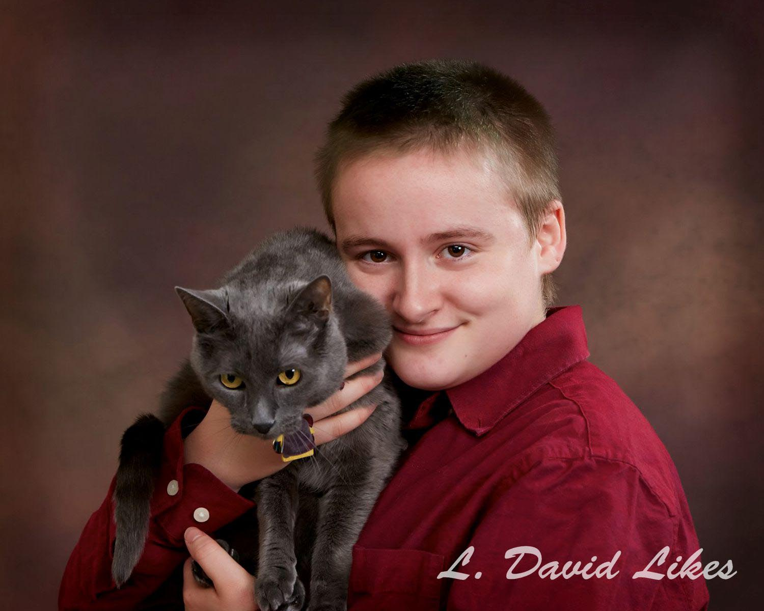 daughter with family cat photo
