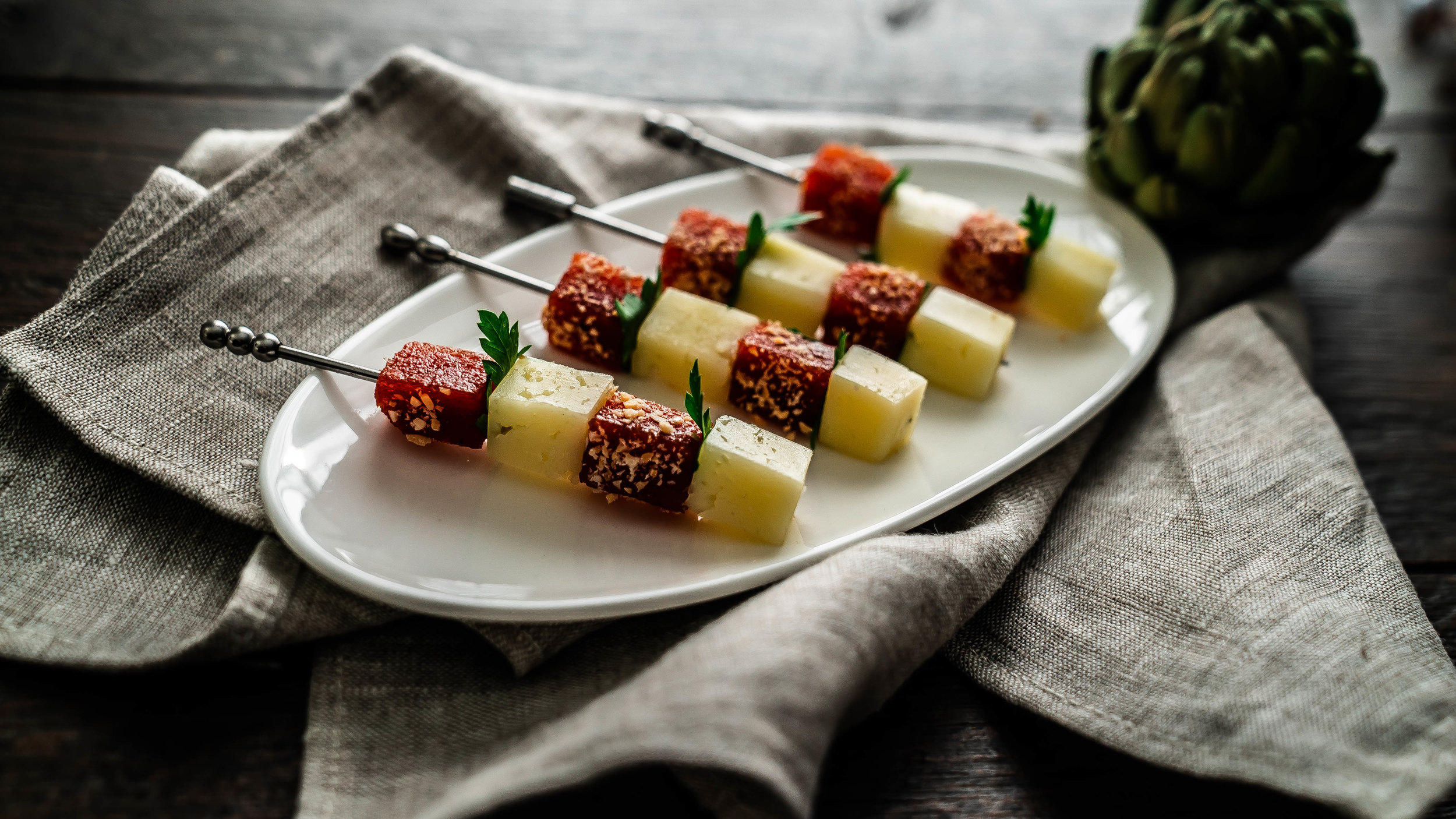 Manchego, quince, and marcona almond skewers