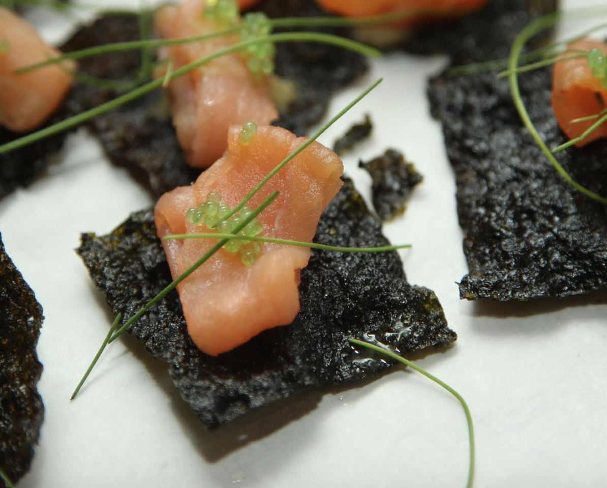 - Smoked salmon on nori chip with wasabi tobiko and micro chives