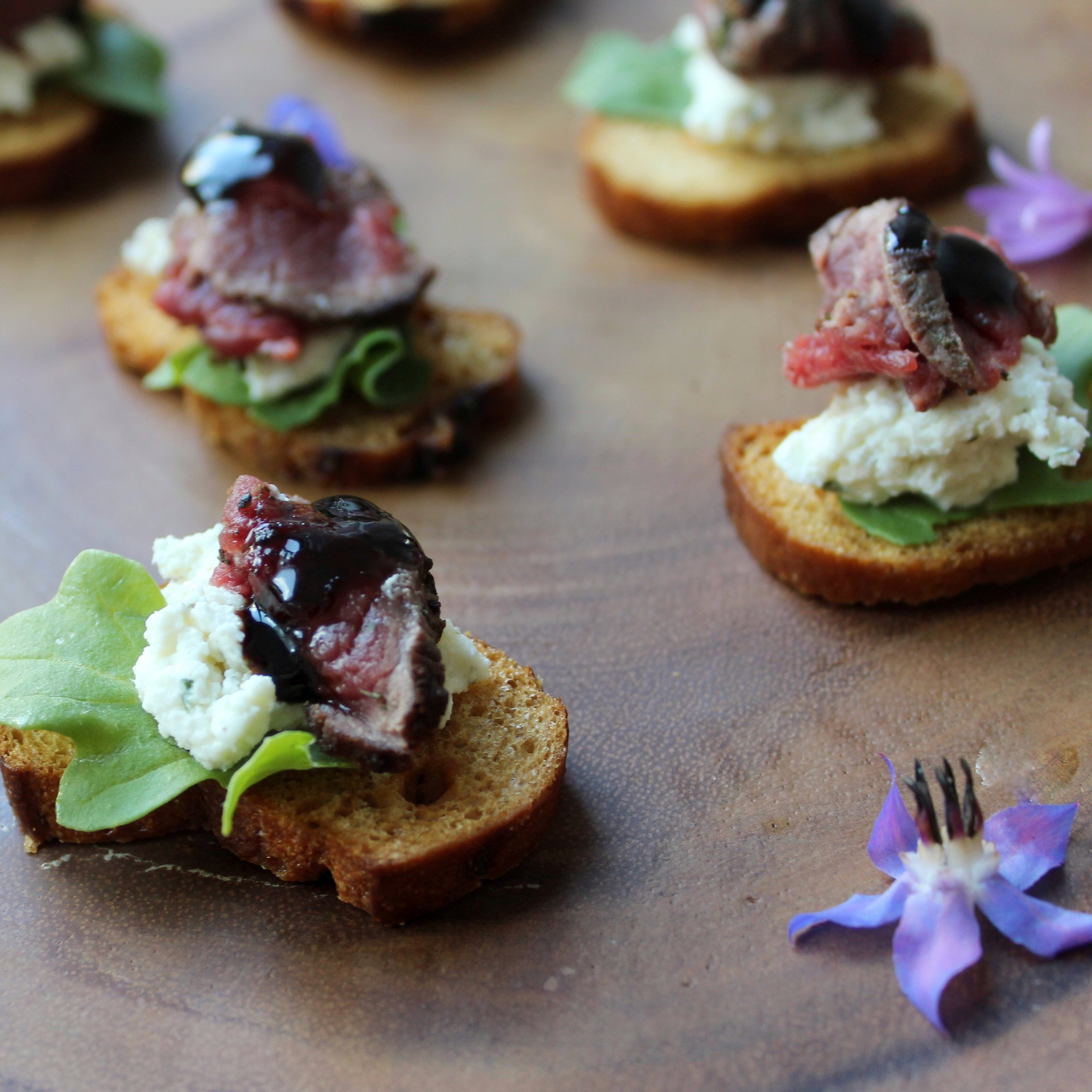 - Beef, balsamic, and herbed cheese on pretzel bread crostini