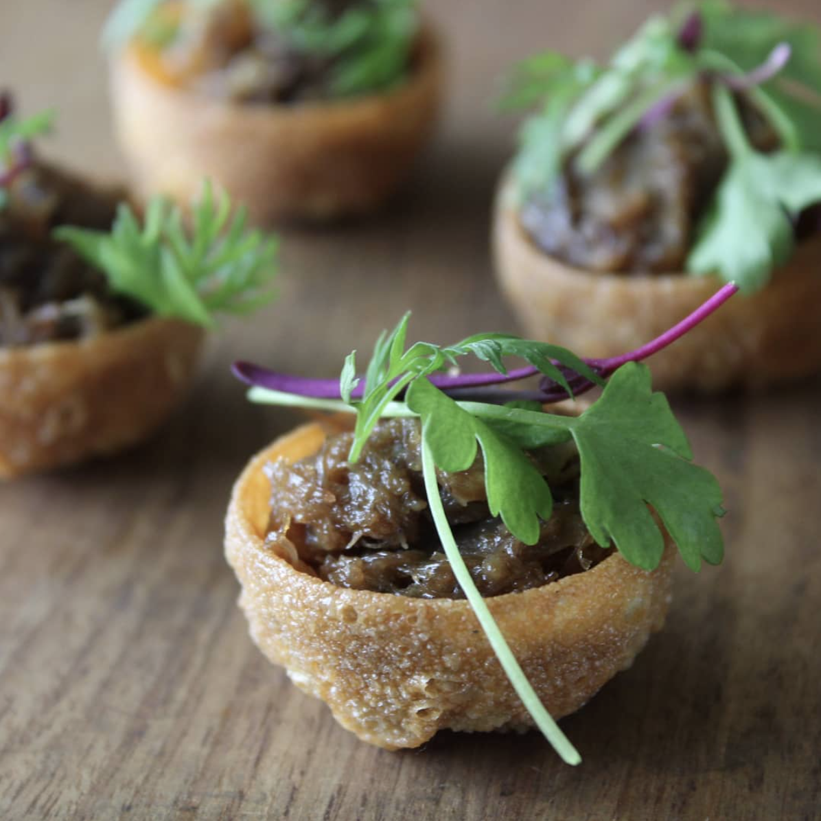- Duck confit croustades with microgreens