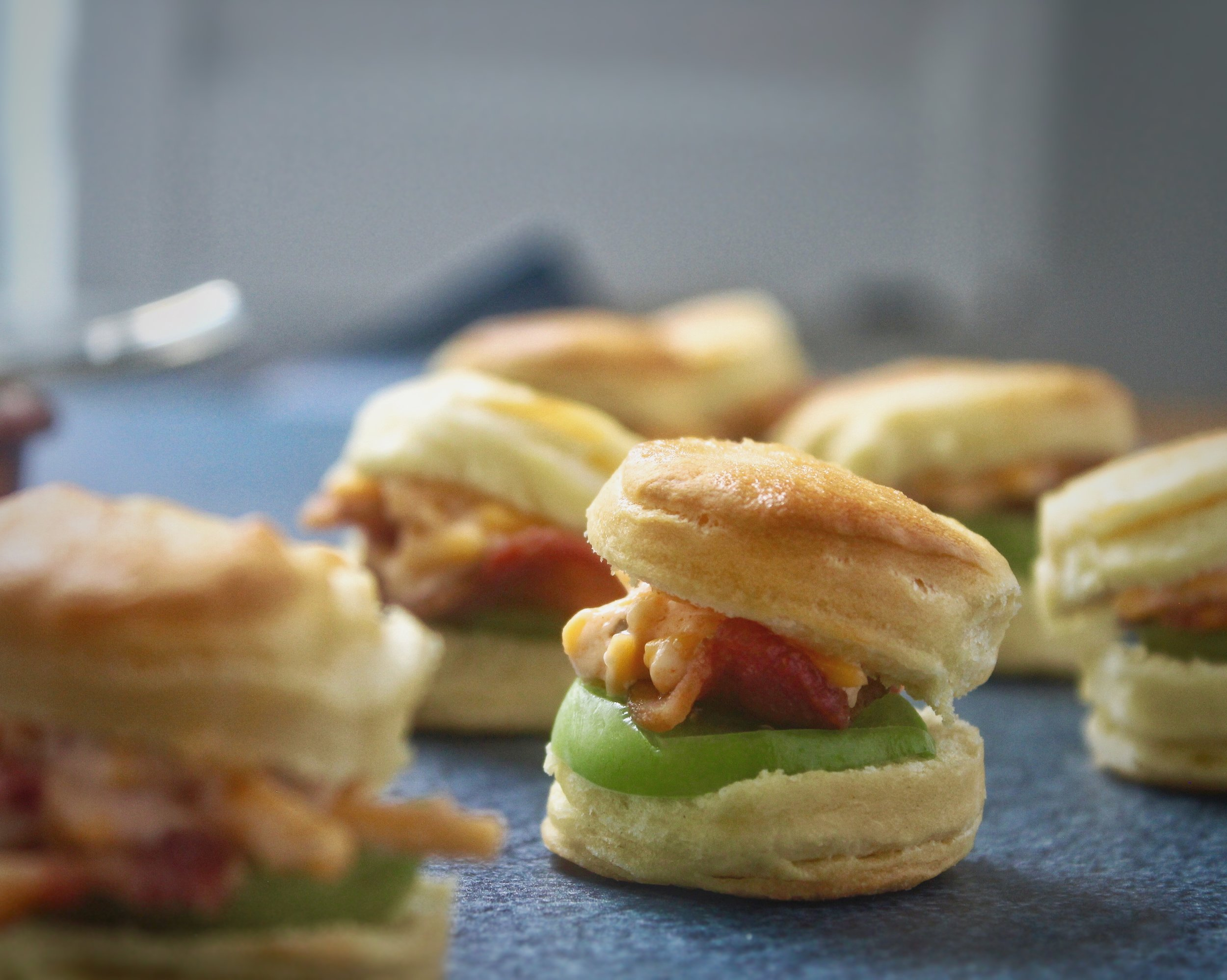 - Mini buttermilk biscuit with bacon, green tomato, and pimento cheese