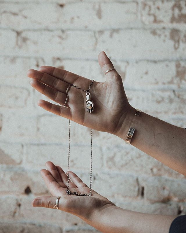 Hands. They do so much. They help us navigate our space, create endlessly, reach out to each other, and so much more. This new line by Everthine Jewelry celebrates everything our hands are, everything they do, and everything they mean. ⠀⠀⠀⠀⠀⠀⠀⠀⠀ This sterling silver hand holds a natural Ethiopian opal stone, and is wearing a 14k gold set blue diamond ring. The bangle bracelets rotates freely. This piece is one of a kind. ⠀⠀⠀⠀⠀⠀⠀⠀⠀ This piece and so much more will be available at the Uptown Art Fair, August 2-4th. Find Everthine at booth 4110 on The Mall. . . . . . #jewelry #shoplocalmn #womanowned #instajewelry #handmadejewelry #jewelrymaking #femalebusinessowner #smallbusiness #jewelrygifts #ringsofinstagram #silverjewelry #silverjewelrydesign #ringstack #messagejewelry #casketartsbuilding #casketarts #nempls #northeastmpls #mnartists #mpls #mplsartist #mnjewelrystudio #uptownartfair #artfair