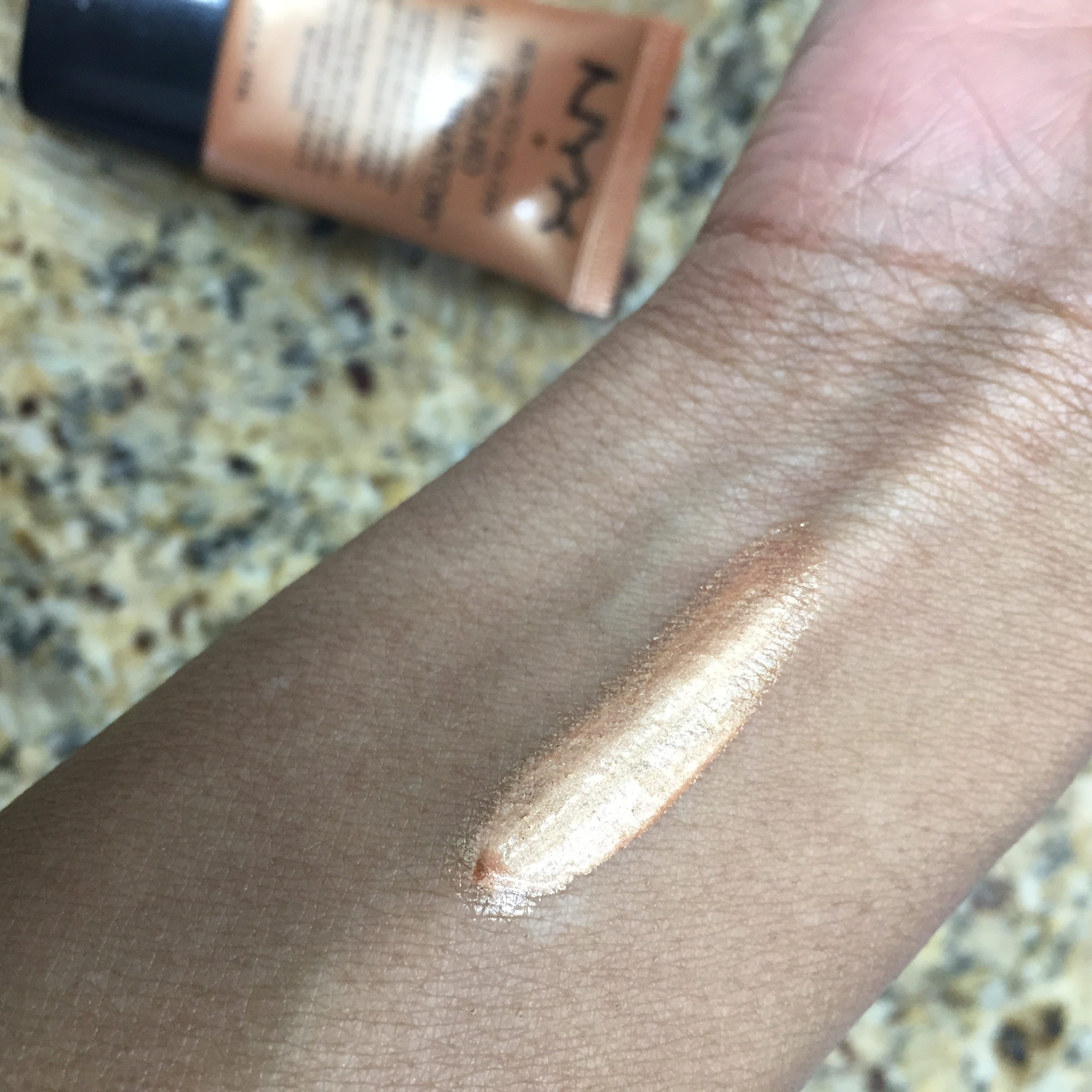 Straight out of the tube, before I blend the product in.