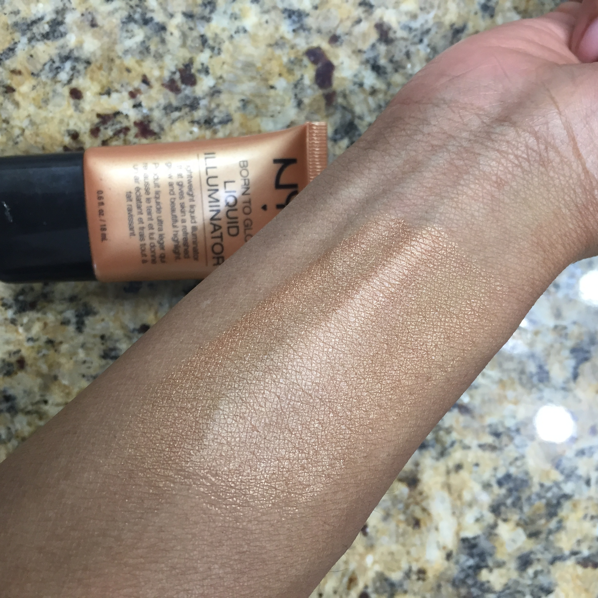 Upon blending the product into my skin, you can see the subtle gold glow that is beginning to enhance my skin.