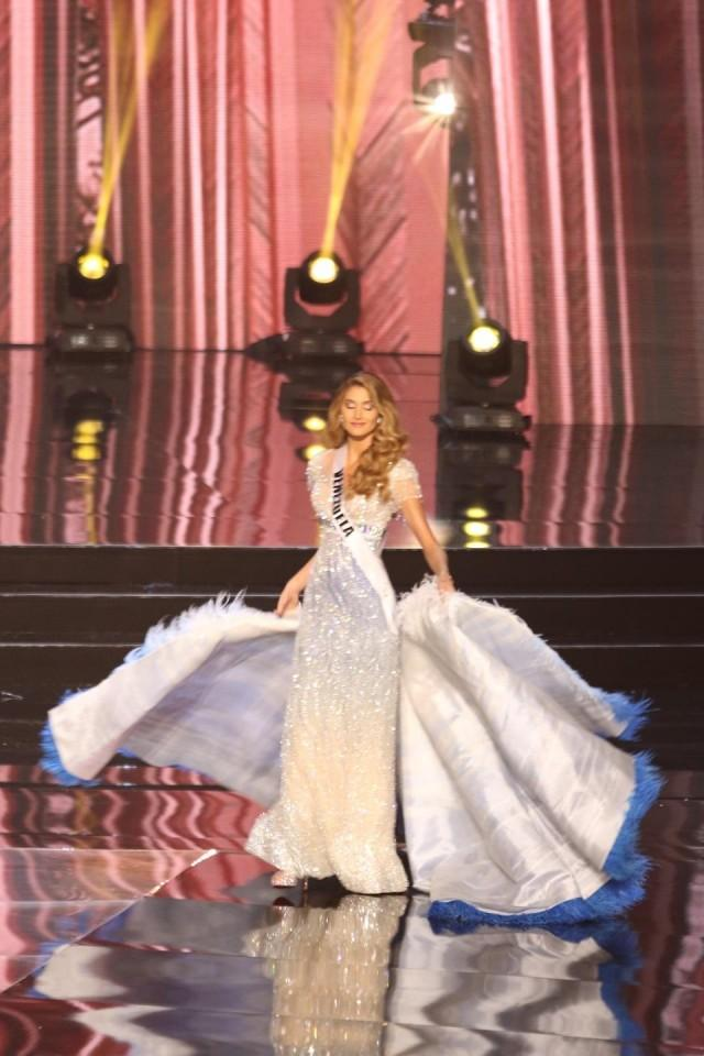Venezuela wows the crowd with a princess moment by transforming her dress in the midst of a twirl!