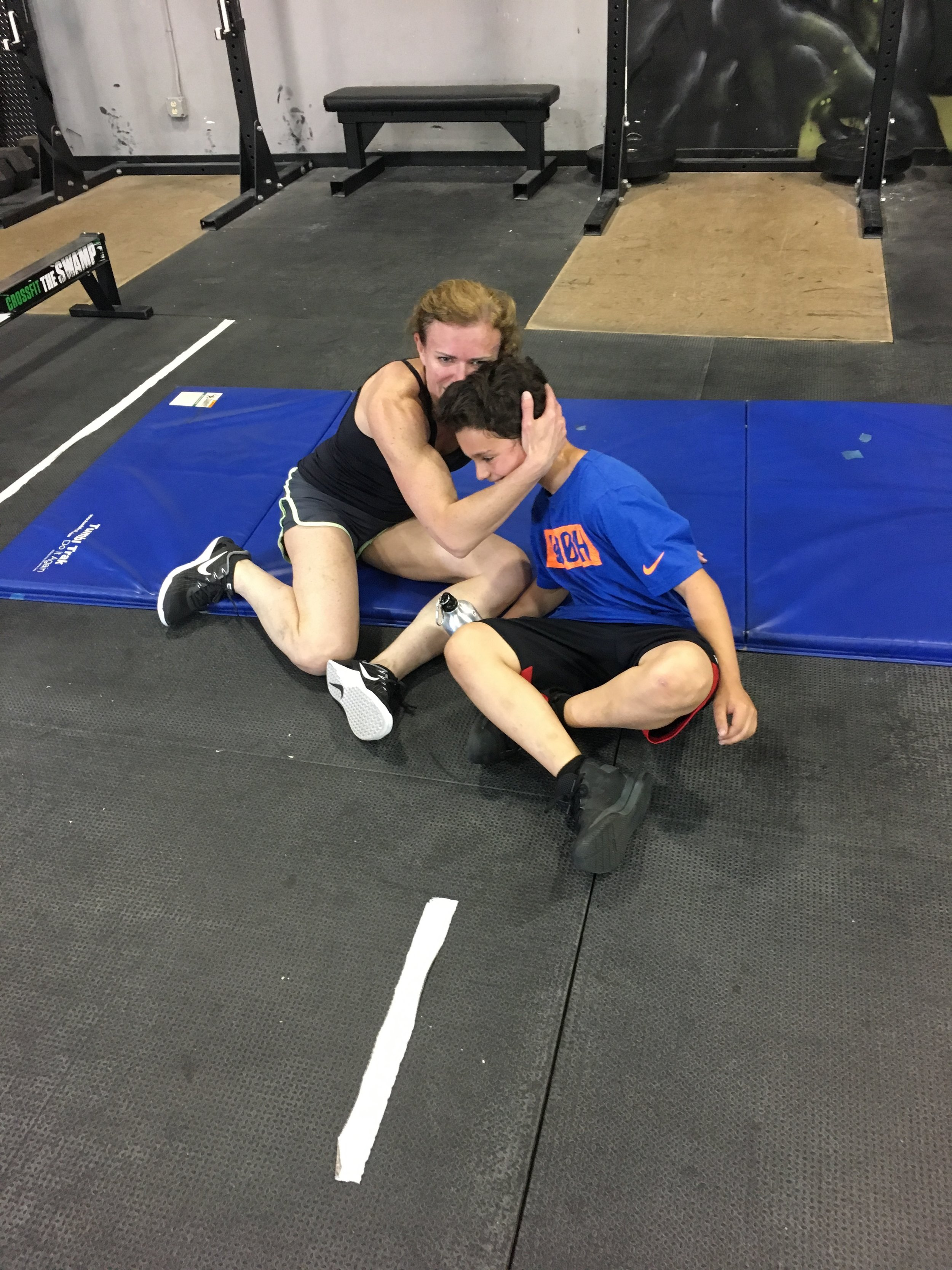 "Special moment today captured as a really special mom and son share a post-WOD hug after crushing ""Jelly Belly"" side by side today. It was AWESOME."