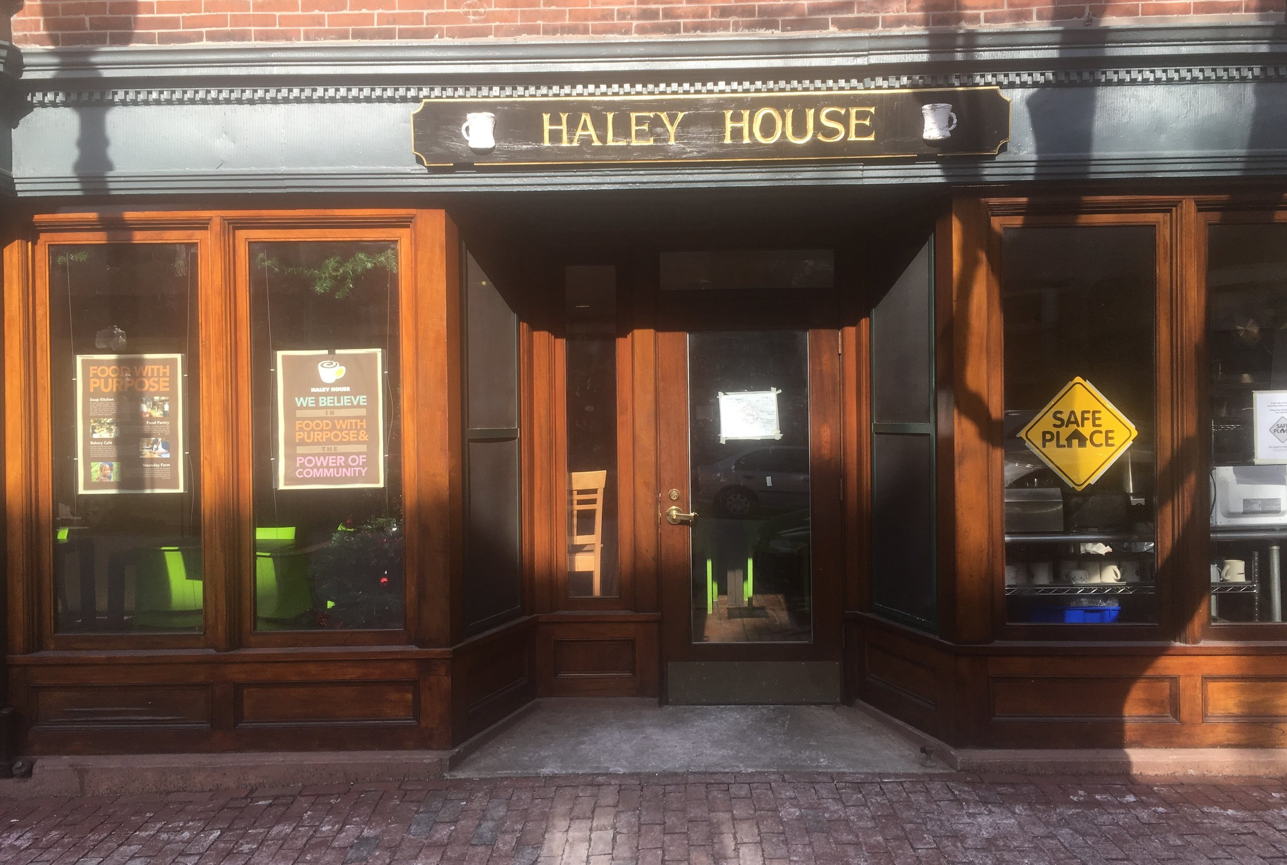 Safe Place signage indicates that Haley House is a key resource for any underage youth in need.