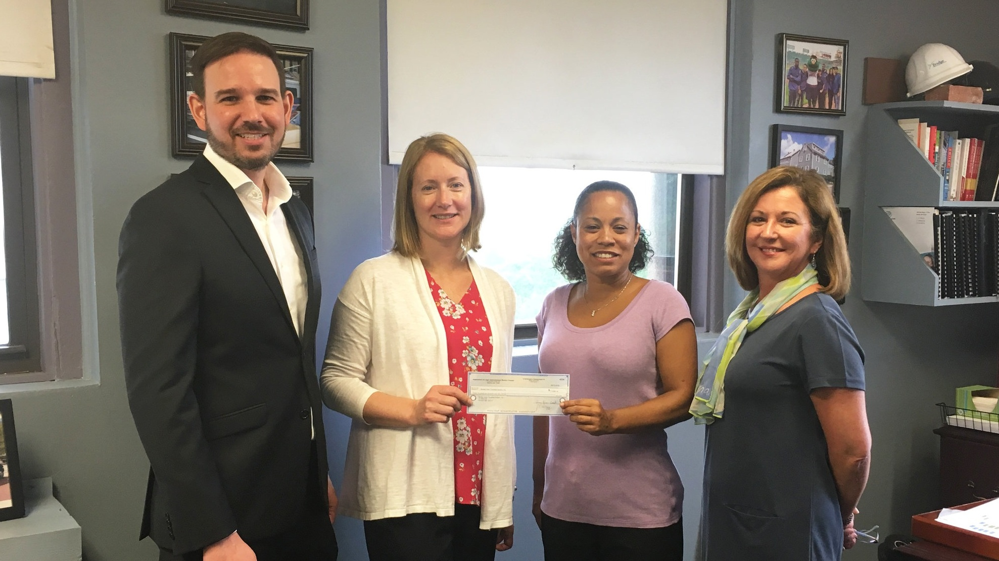 Tim Hardin (Cesari and McKenna, LLP), Amy McDuff (Murtha Cullina, LLP), and Ginni Klier (Kotin, Crabtree & Strong, LLP) presented a check to Elisabeth Jackson (second from right), Executive Director of Bridge Over Troubled Waters.
