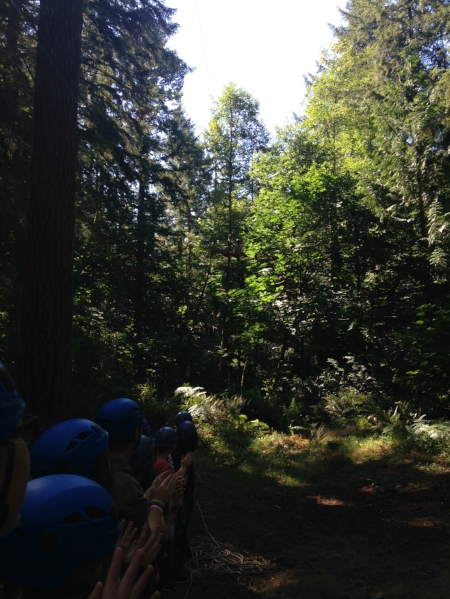 Having fun with team-building on a ropes course! Can you spot Megan flying through the trees?