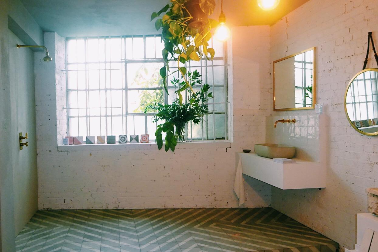 Concrete shower wall + statement floor tiles