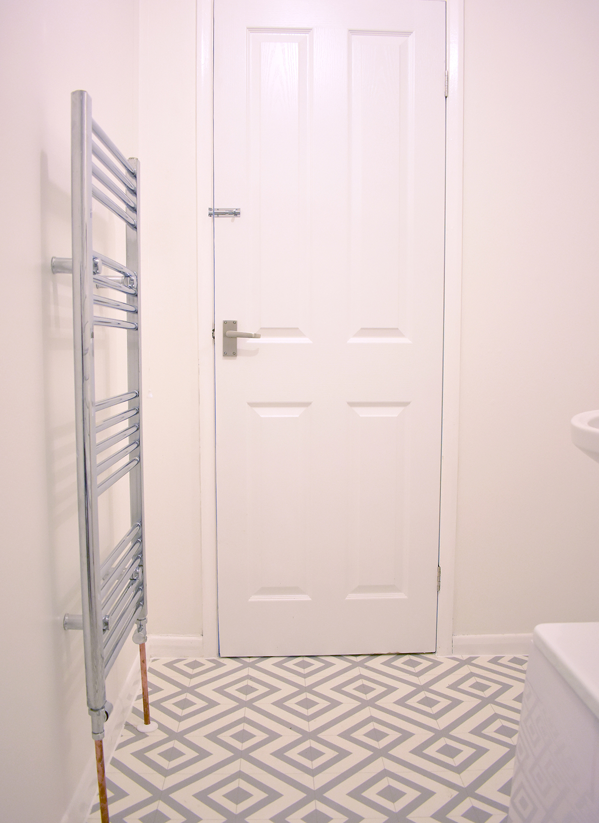 The towel rail and copper piping finish the bathroom renovation nicely