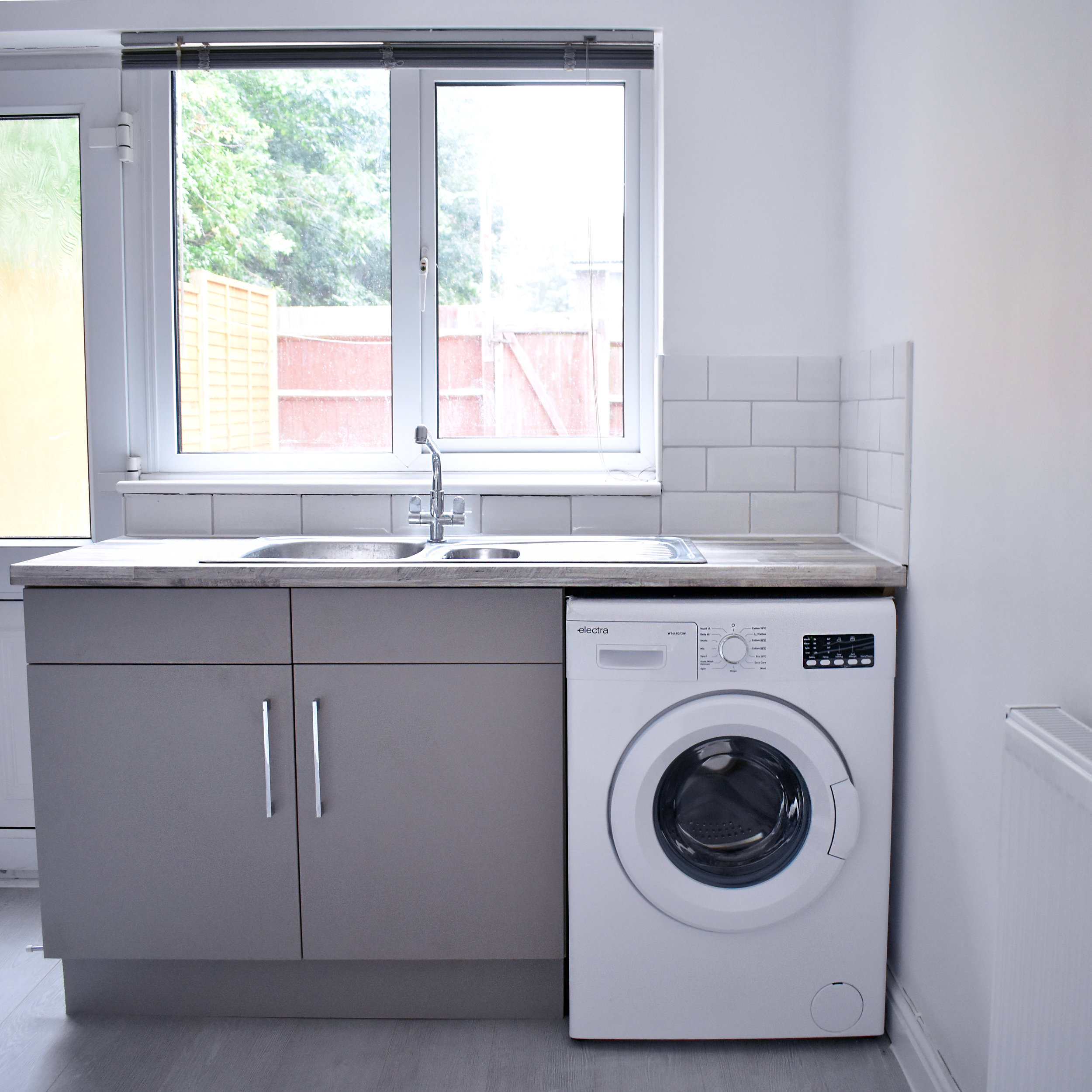 We chose white metro tiles from B&Q to keep the kitchen bright and airy.