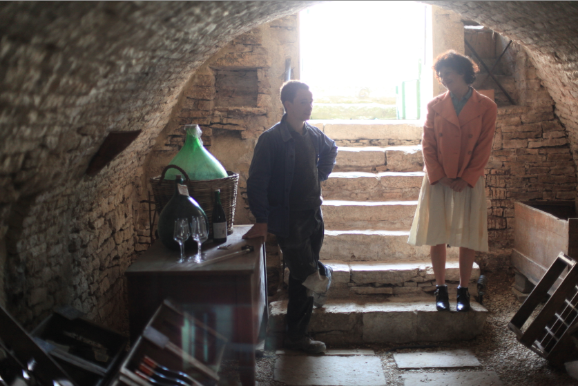 Winemaker Pierre Paillot with actress Alia Shawkat on location in Noyers-sur-Serein, France