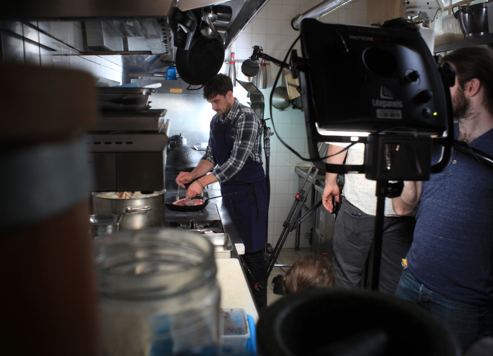 Filming with chef James Henry in the kitchen at Bones restaurant in Paris