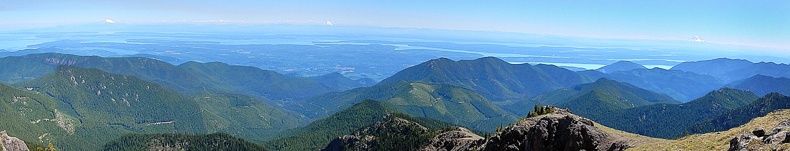 View of Mount Baker, Mount Glacier and Mount Rainier from the top of Mount Townsend