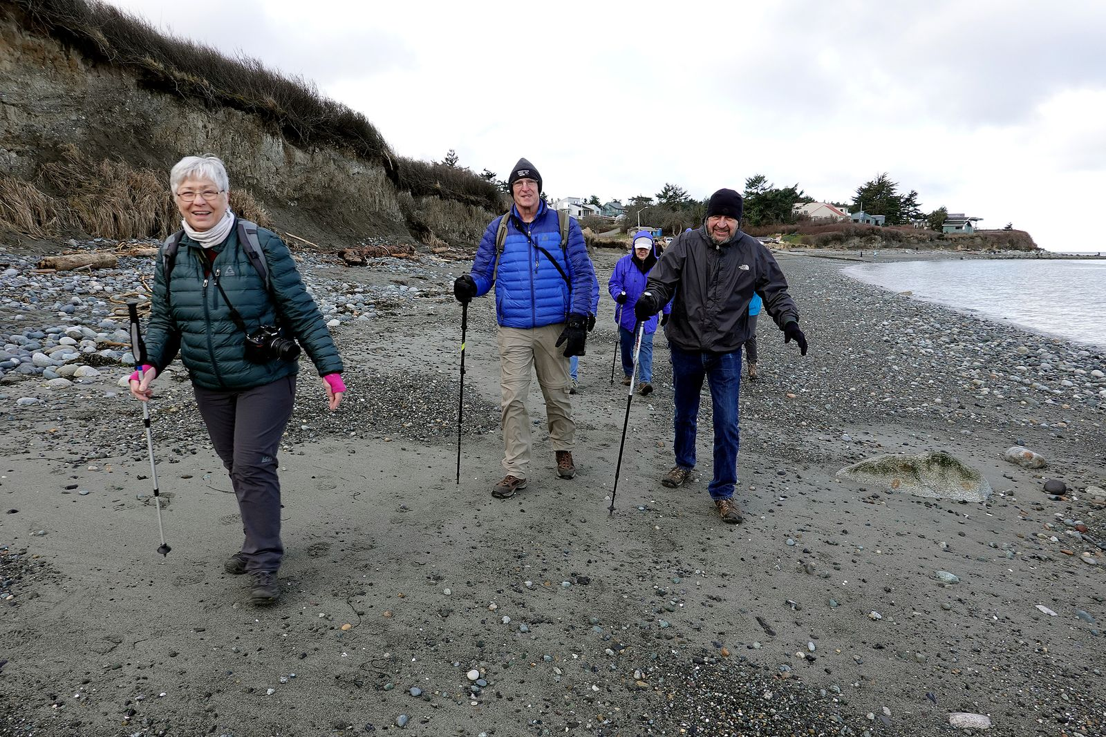 Sam, Andy and Denny appear to enjoy their stroll along the beach