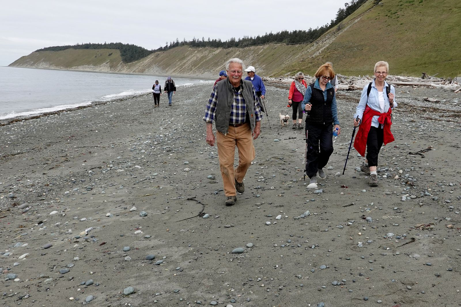 Jack, Judi and Sue walking on the beach