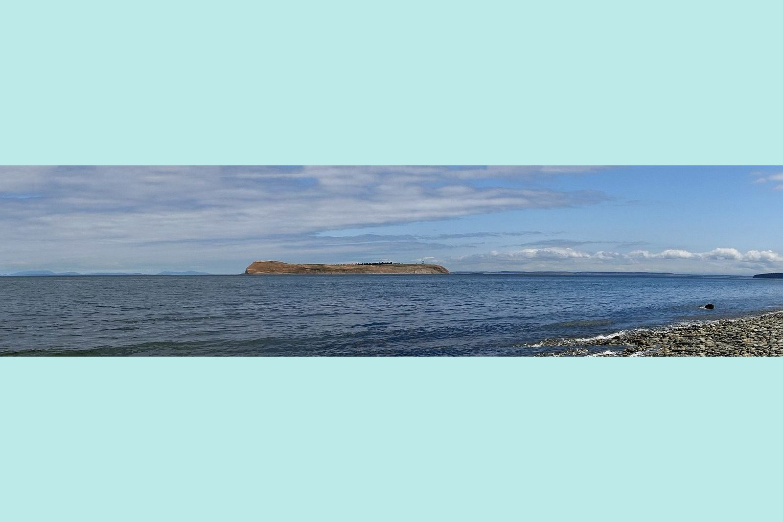 Protection Island with San Juan Islands background left