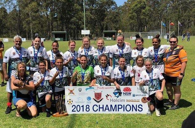Jenna Rose (back, 4th from left) and Sarah Hanlon (back, 5th from left) with the victorious Illawarra Bungarras team.