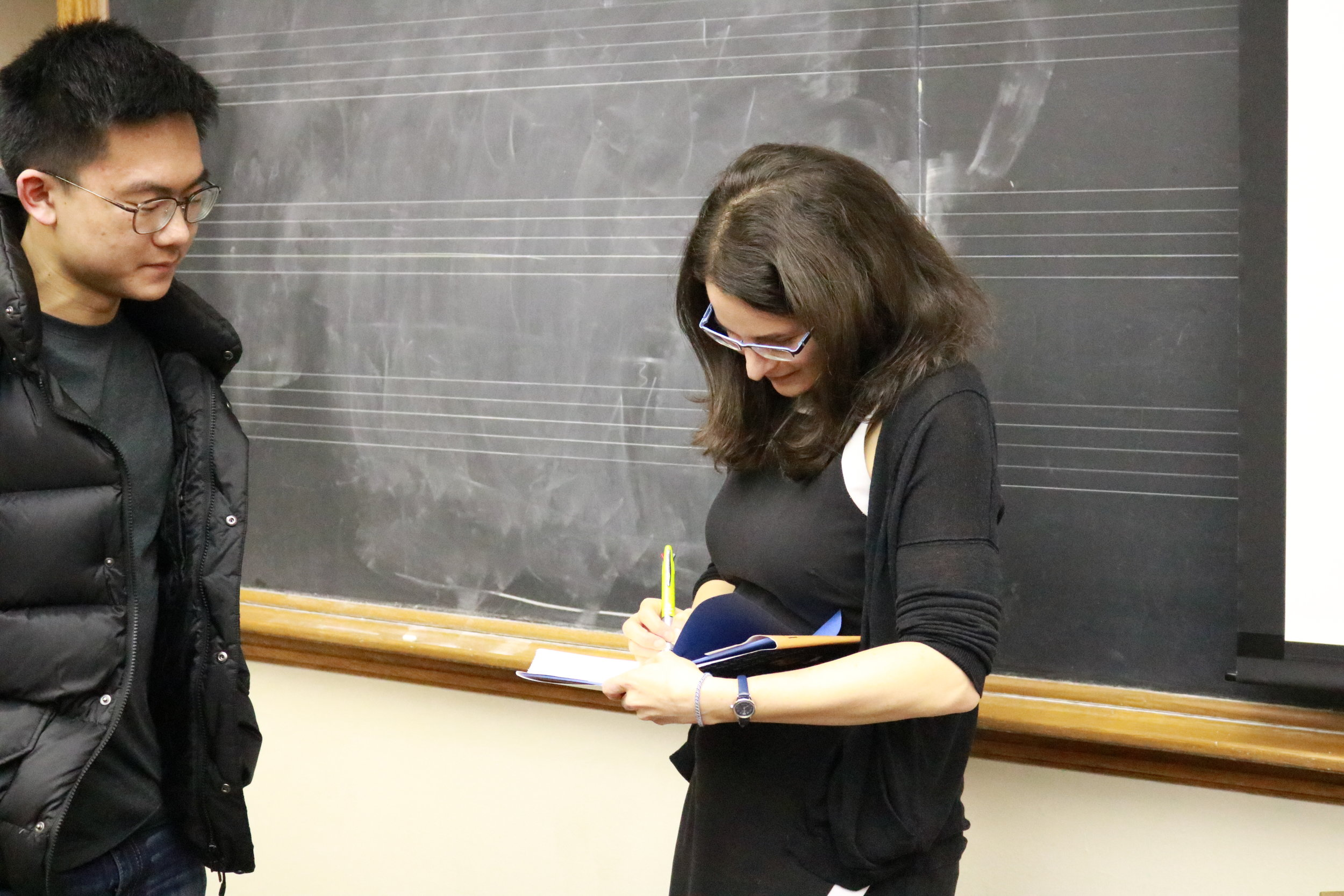 Sarah Hurwitz signs a student's copy of her book after a speaker event.