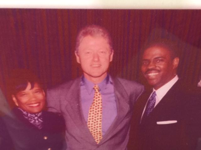 Professor Mark T. Harris, Esq. and Dr. Marianna Harris, EdD. with President Bill Clinton