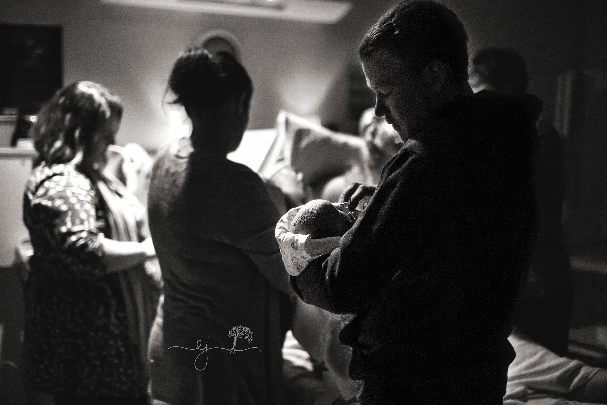 Steph Daniel holding baby.jpg