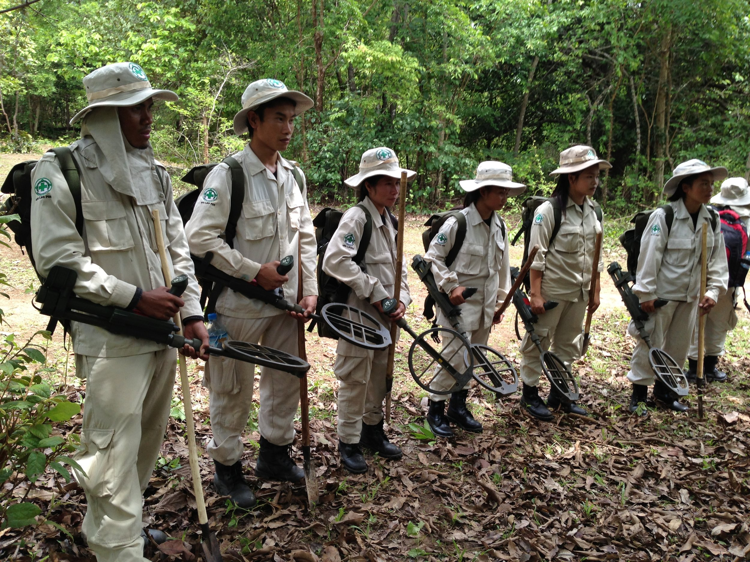 Laotian deminers, part of a Norwegian NGO in the jungles of Laos. Photo: Mike Blanchfield