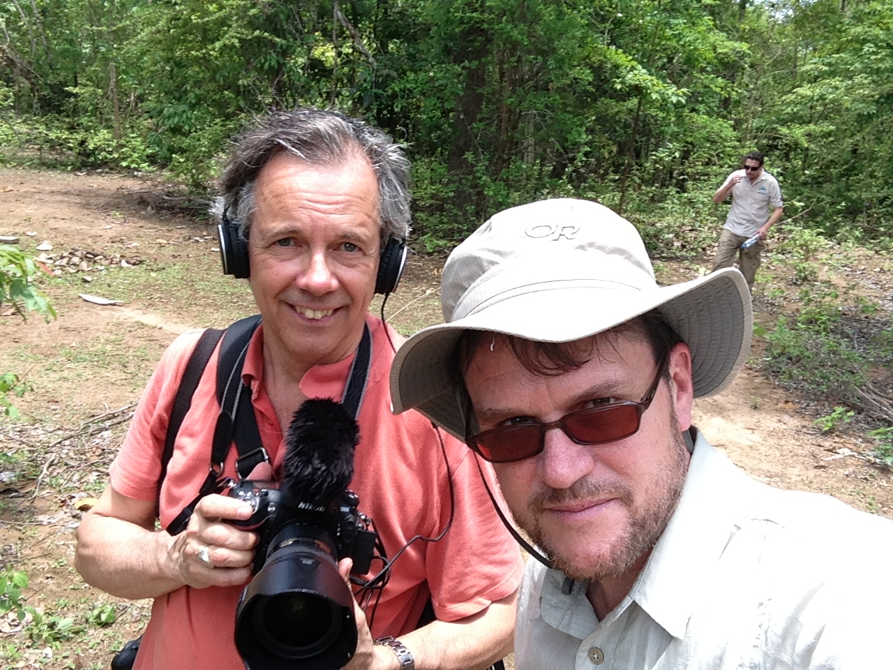 Canadian Press photographer Paul Chiasson and Mike Blanchfield coming out of the jungle in southern Laos after accompanying deminers. Photo: Mike Blanchfield.