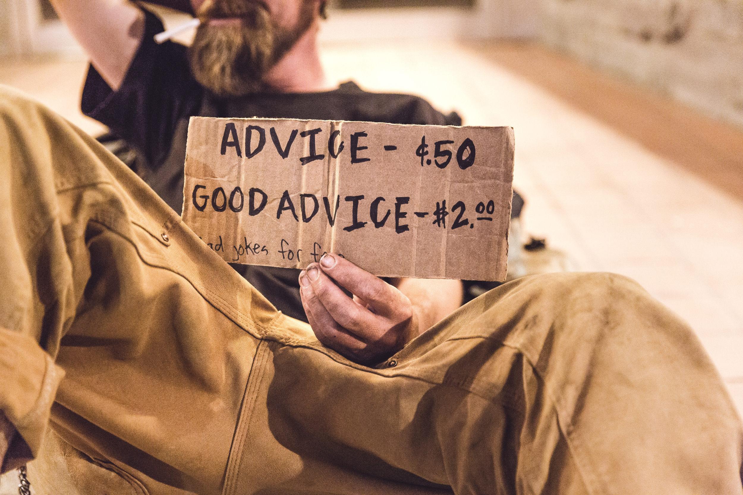 man with advice sign on cardboard, counseling in columbia mo