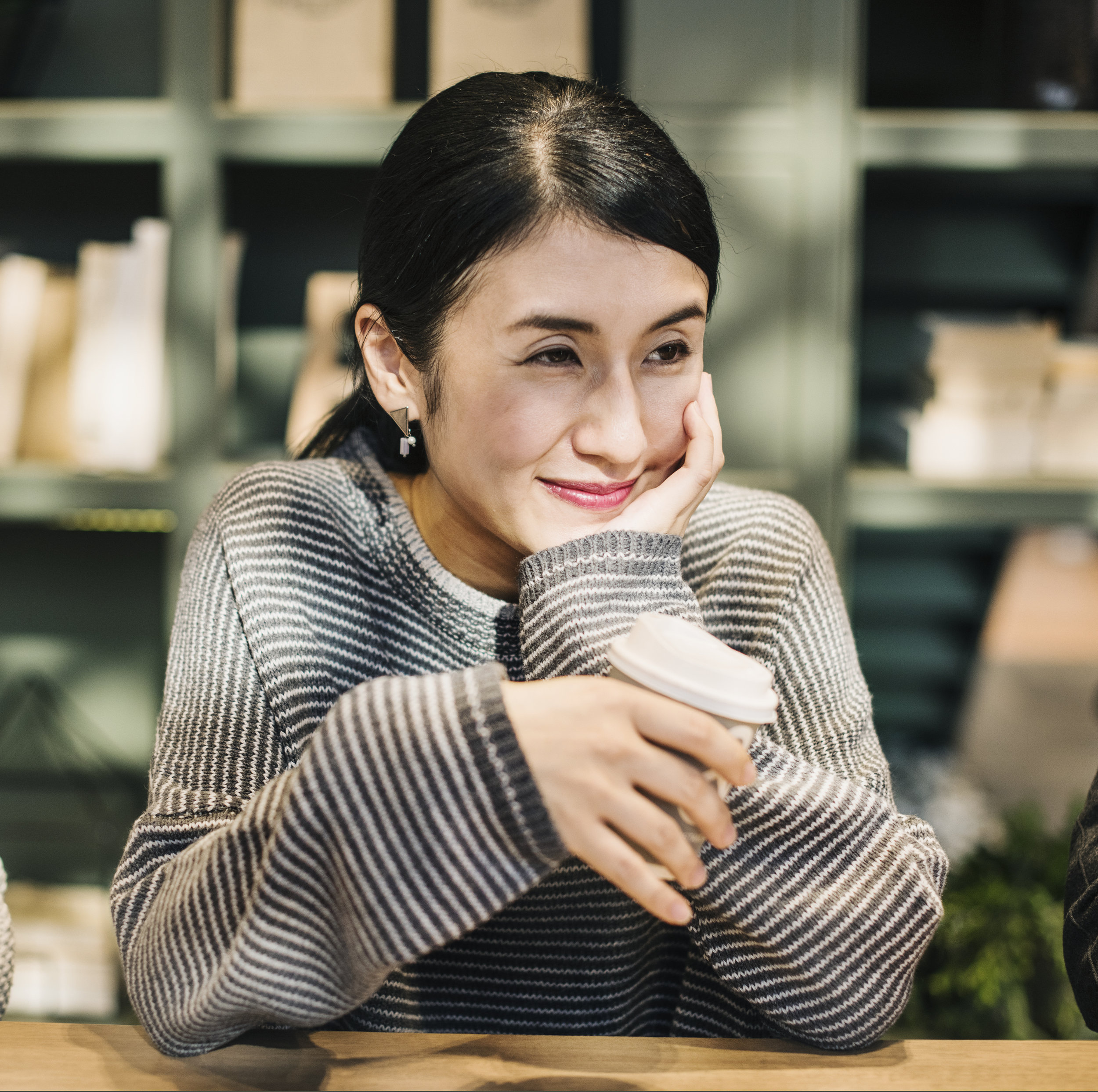 asian woman with coffee, counseling in columbia mo