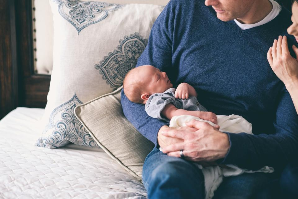 parent holding baby, newborn baby