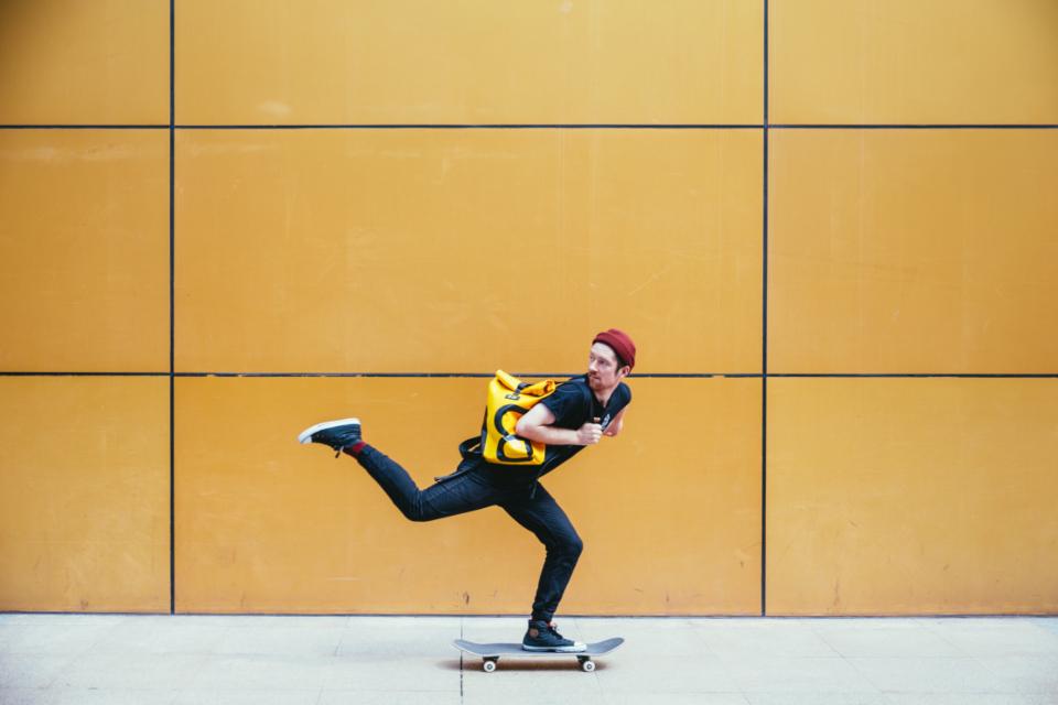 guy on skateboard, yellow wall, moving on skateboard