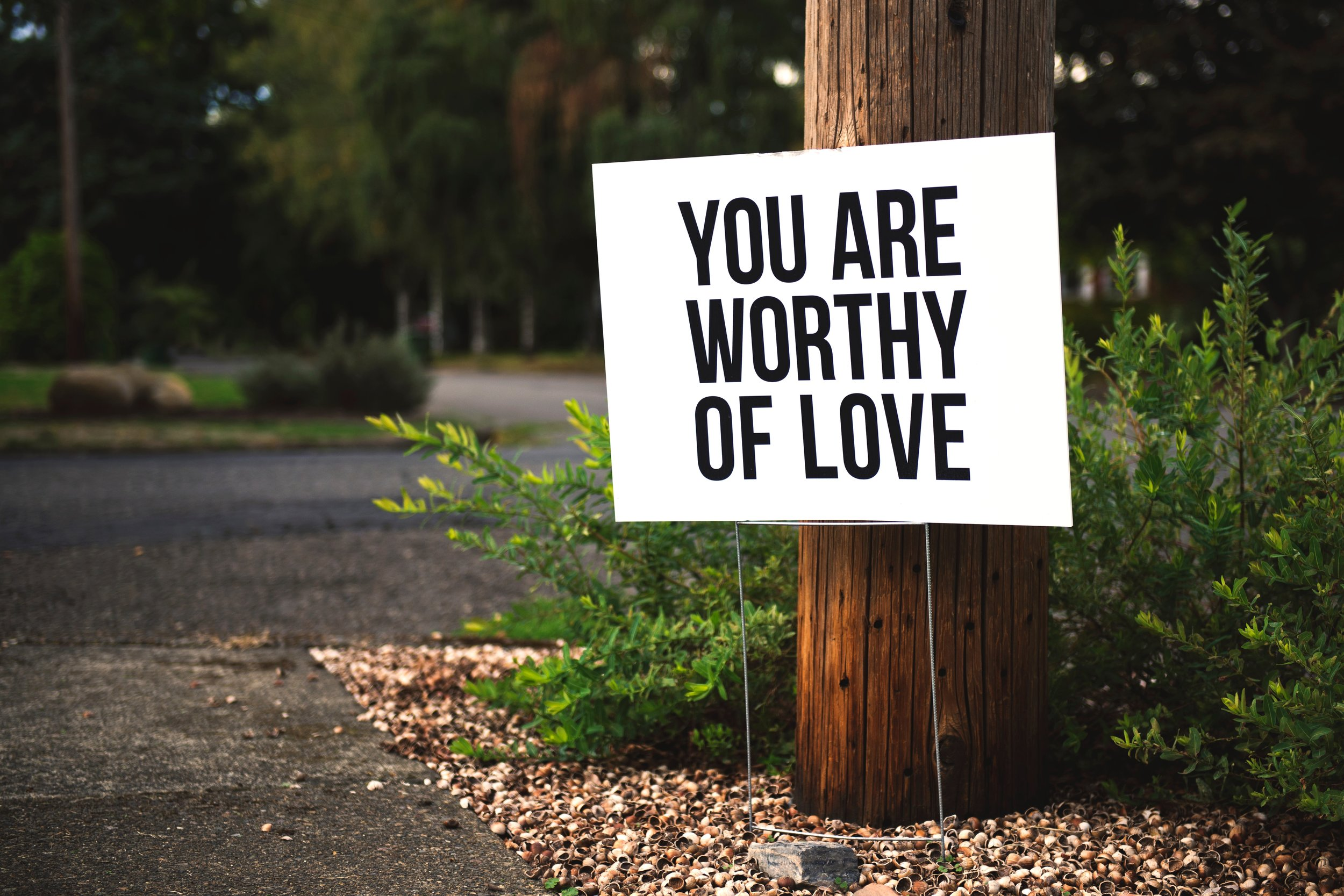 you are worth of love white sign with black lettering, body image counseling columbia mo, body image therapy 65203