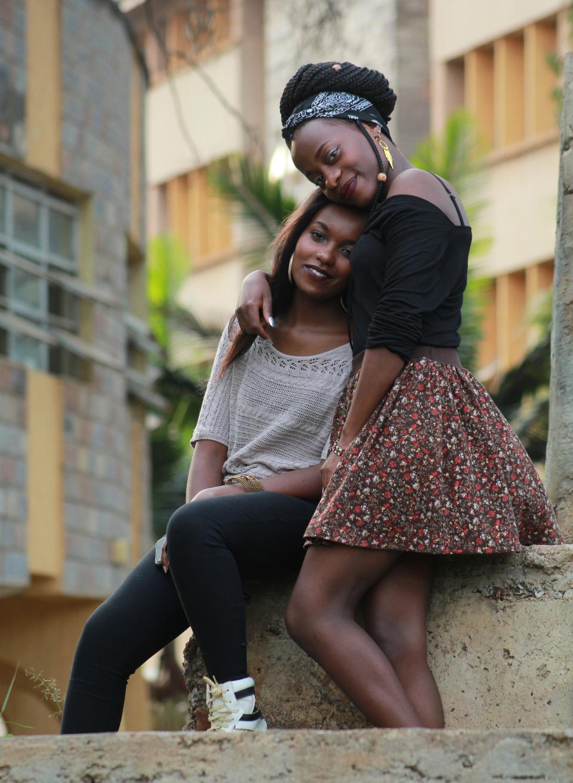 best friends, girls hugging, female hugging, people smiling at camera, earrings, skirt, downtown