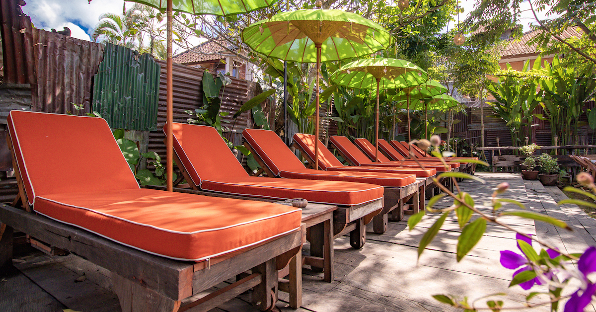 SUN LOUNGERS   10 loungers looking over the entire space with a single person seater are free to book; a bale (divan) located at the corner of the lawn is suitable for 4 adults or 2 adults and 2 children at IDR 350.000 net, book them   here  .