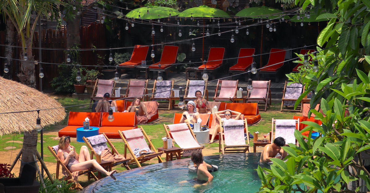 POOLSIDE CHAIRS & SOFAS   A two-seater cozy sofas and single pool chairs are located at the lawn area facing the pool, they are free to access. Book a spot   here  .