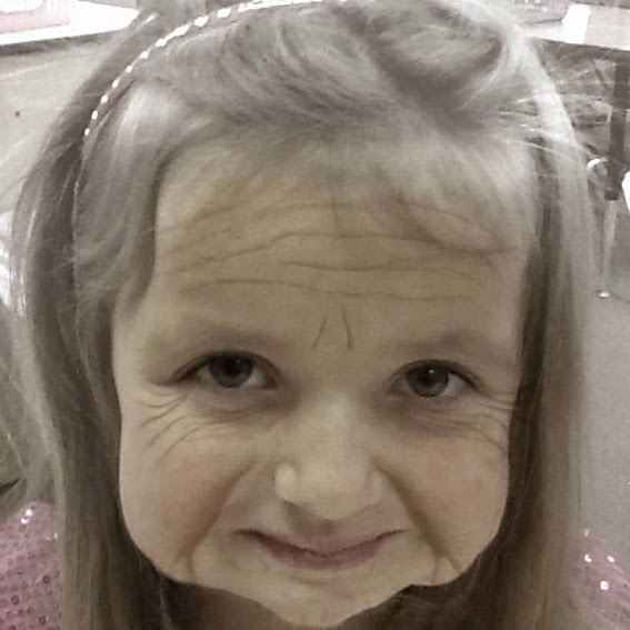 A picture taken with Aging Booth. This makes a fun portfolio page if you save the pictures and have the kids write about what the world will be like when they're 100 underneath the photo.