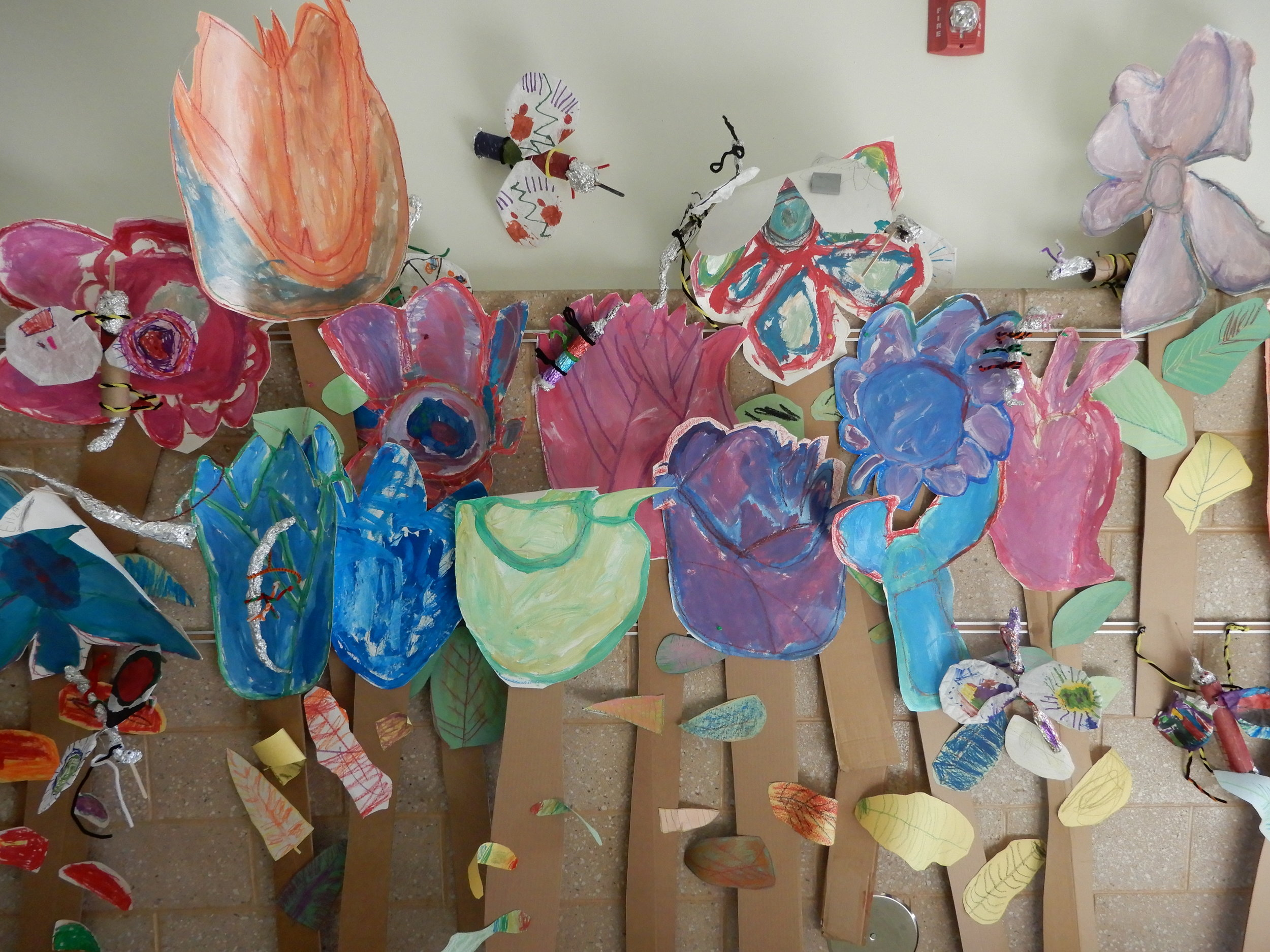 """This is a display of giant flowers made in the art room under the guidance of """"Art Coach."""""""