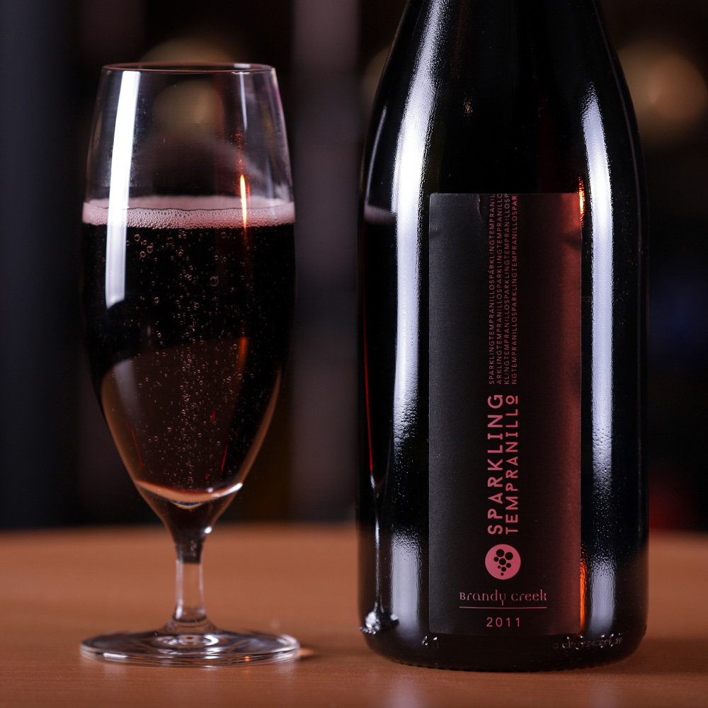 2014-Sparkling Tempranillo - Ruby red in colour, aromas moves from strawberries, raspberries to cinnamon & cloves spices underlying with cracked black pepper and cherry kirsch. Persistent & lingering mousse Dark plums, raspberries and liquorish giving way to playful wooded curry spices on your palate with long finish.