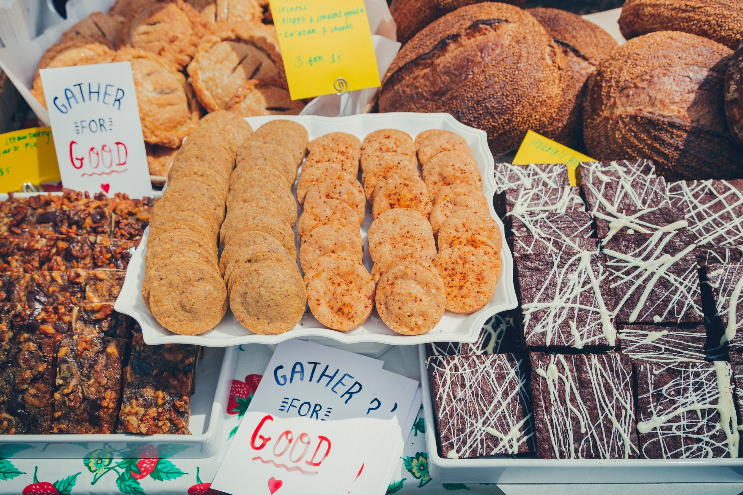 """Image depicts a photo of various baked goods for the event """"Gather for Good"""", a fundraiser and an example of the past work with nonprofits that Here's Looking at You has participated in."""
