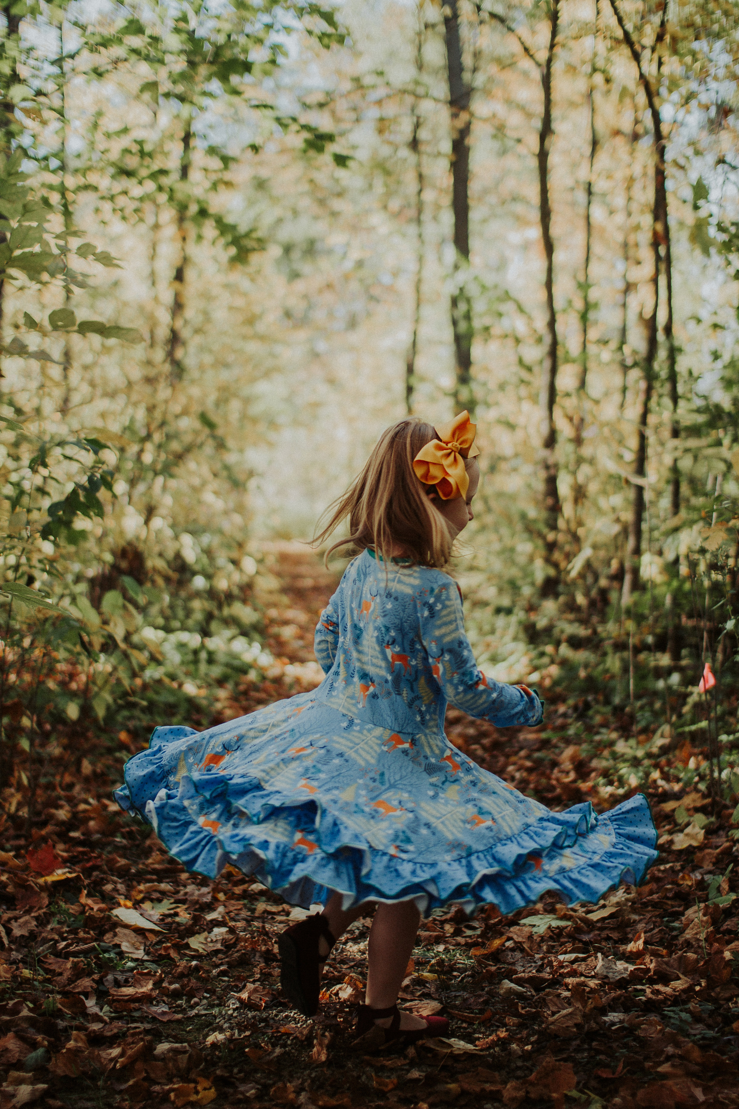 Nothing's cuter than kids throwing leaves and twirling their dresses, which Jovie did pretty well for her 4th birthday photos.