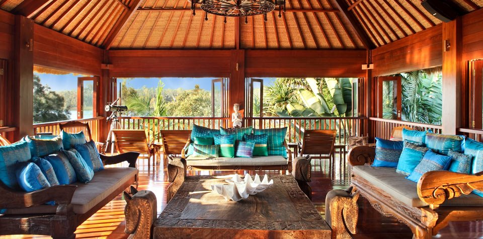[A space to linger and pause, overlooking the river. All the furniture used were antiques sourced in Bali.]