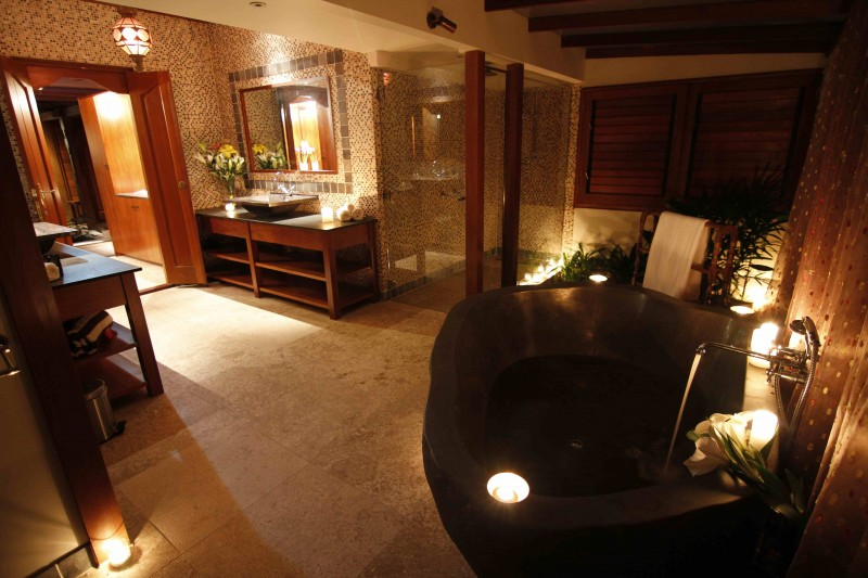[The bath is carved from one solid piece of rock, and is a striking feature in the Villa Bathrooms].