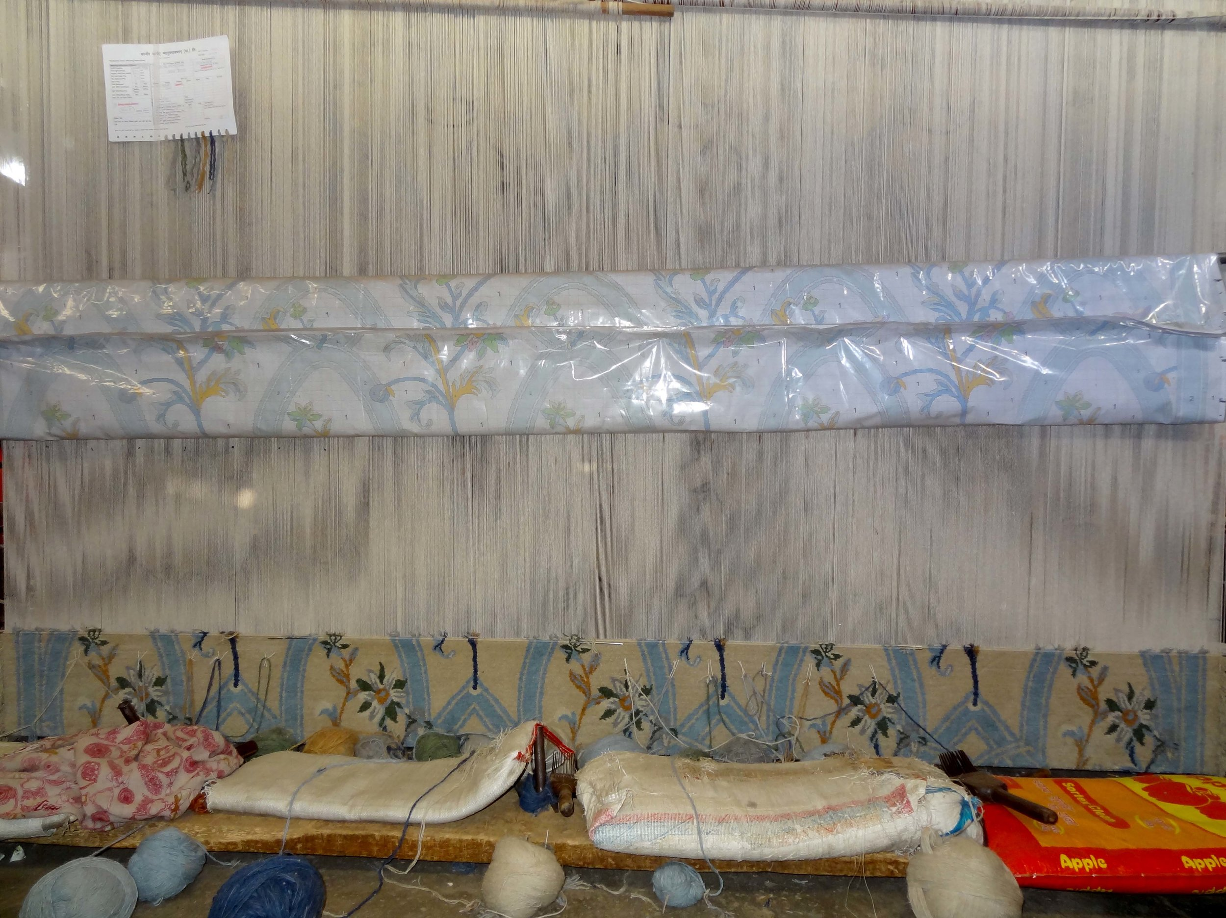 The rug is being woven on the loom, above this image is the sample that arrives first, to be approved and then production begins. All this starts with a sketch, then arrives as a fished rug. This rug was created for a home in Western Suburbs of Brisbane, it will finish the room perfectly.