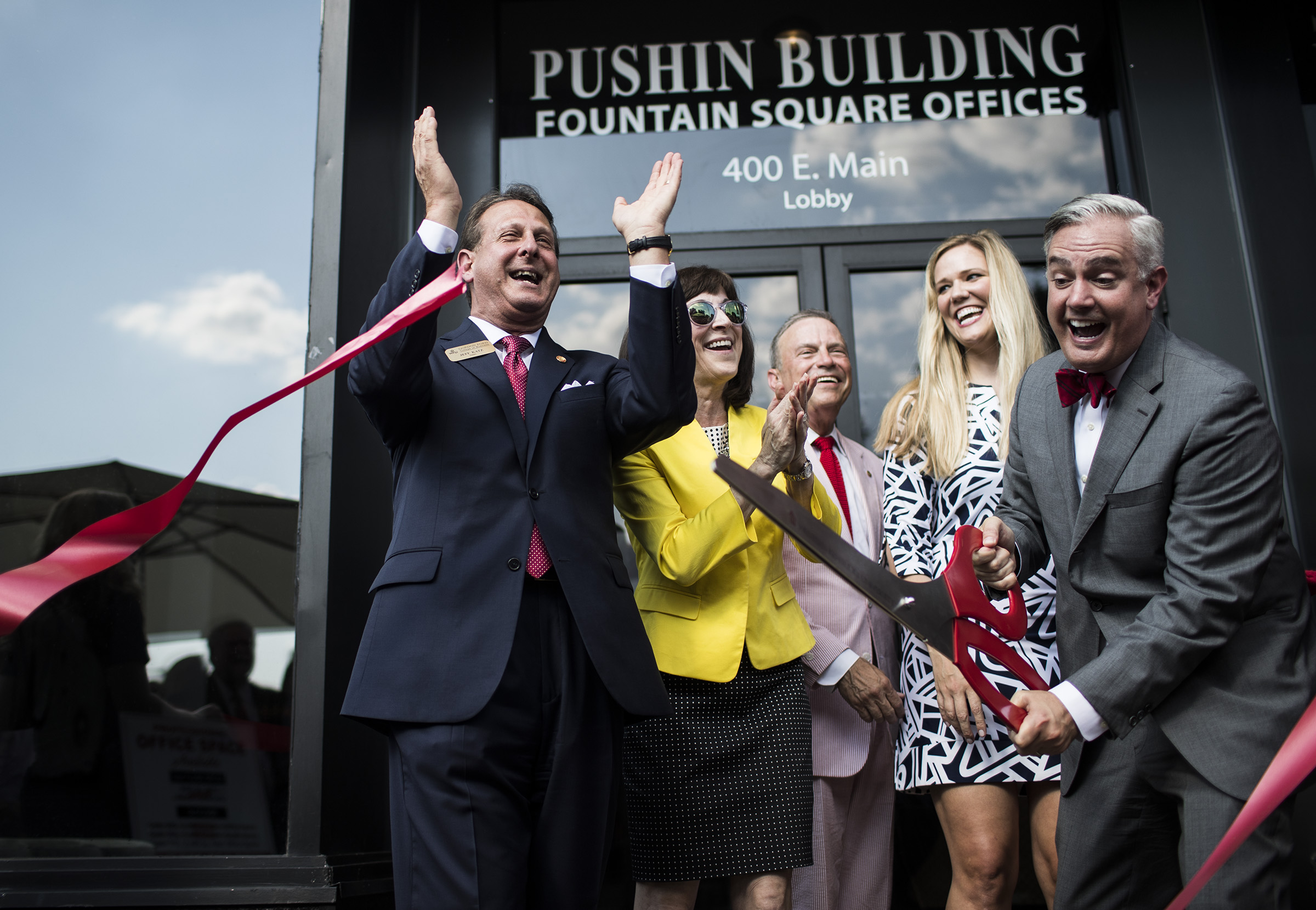 From left, Gordon Ford College of Business dean Jeff Katz, Carolyn Ridley, WKU regent John Ridley, Kacy Caboni, and WKU president Timothy Caboni cut the ribbon for the opening of the Gordon Ford College of Business location in the Pushin Building on Tuesday, August 8, 2017, on the square in downtown Bowling Green.