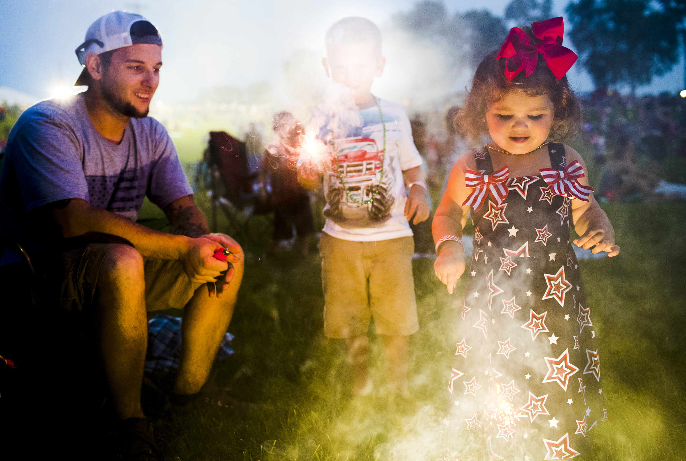 From right, Ashlynn Zinman, 2, plays with sparklers with her brother, Carson Zinman, 5, and father Anthony Zinman, all of Glasgow, Ky., during Thunderfest on Sunday, July 2, 2017, at the National Corvette Museum in Bowling Green, Ky.