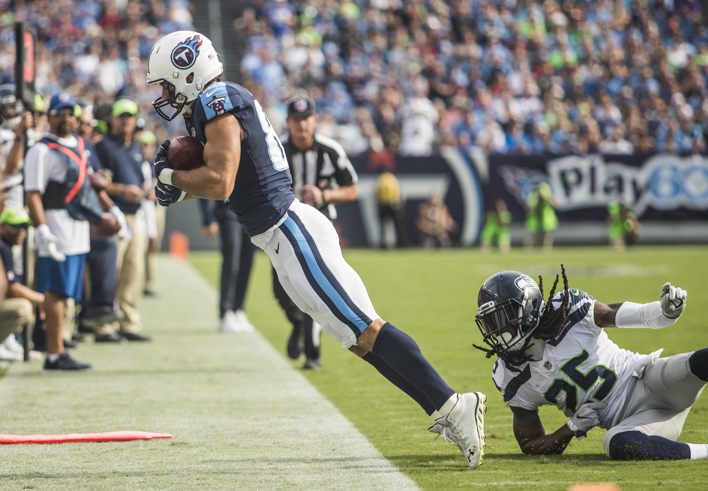 Tennessee Titans wide receiver Eric Decker (87) makes a catch on the sideline while guarded by Seattle Seahawks cornerback Richard Sherman (25) during the Titans' 33-27 win over Seattle on Sunday, Sept. 24, 2017, at Nissan Stadium.