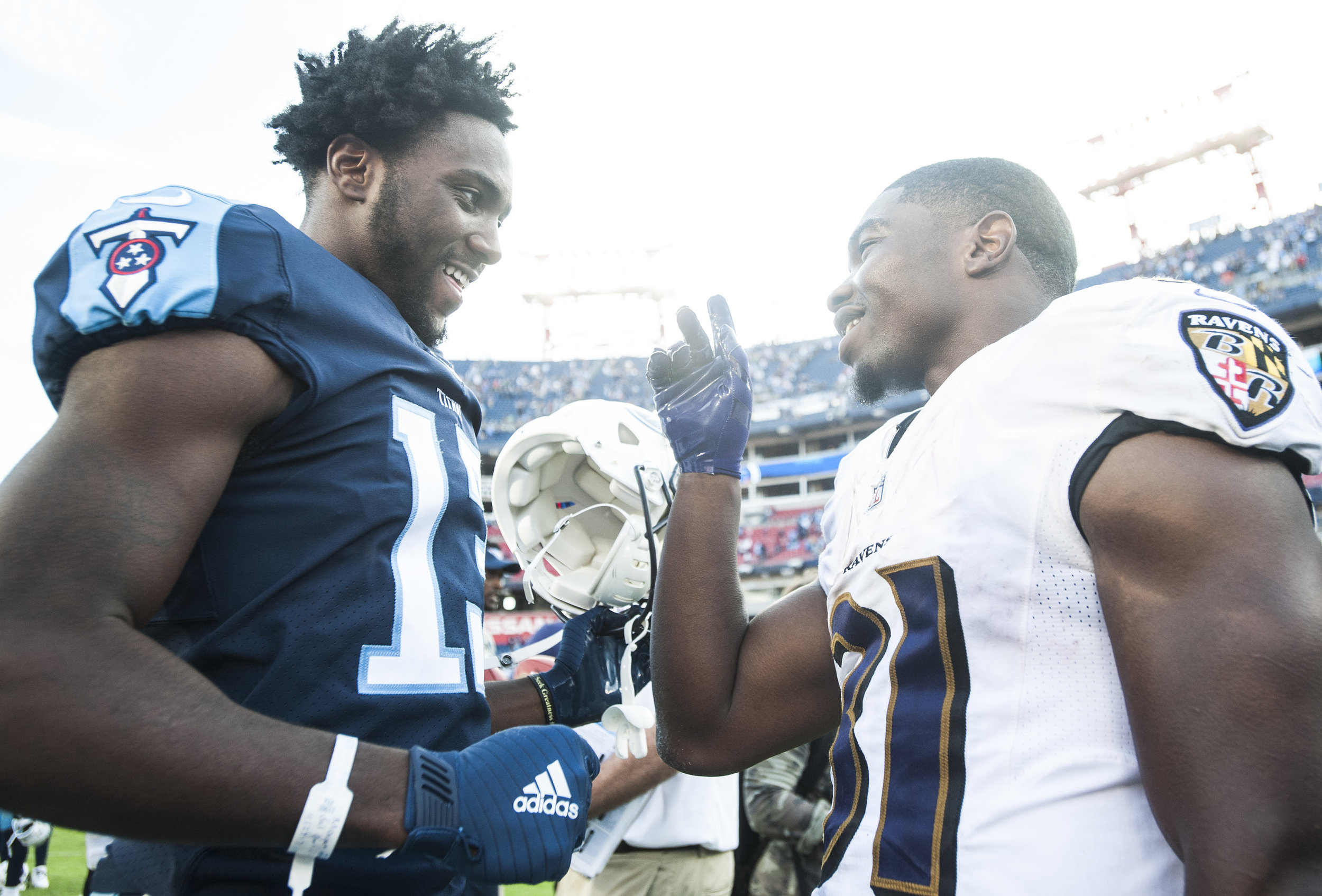 Tennessee Titans wide receiver Taywan Taylor (13) talks to Baltimore Ravens running back Bobby Rainey (31) after the Titans' 23-20 win over Baltimore on Sunday, Nov. 5, 2017, at Nissan Stadium. Rainey is the first Hilltopper since the program's transition to the FBS to make a career in the NFL.